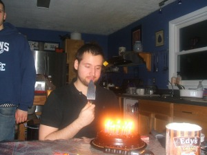 look at the cake with all them candles. his brothers ended up blowing them out